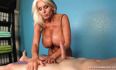 This mature woman gives him a handjob!