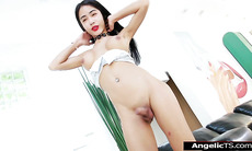 Asian shemale Milk B jerks off her cock