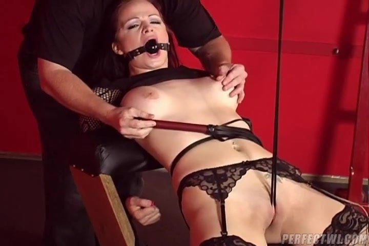Brunette bondage virgin is flat on her back, legs wrapped in plastic